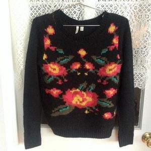 Black knit sweater with flower design